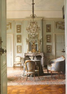 Beautiful pastel mint walls and furniture. And that Persian rug!  #interiordesign #chateau #livingroom #chandelier #decorativemolding #antique #decor #french