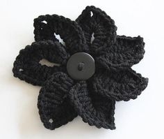 I really like the chic petal shape and classic jet black hue of this lovely crocheted flower. #howto #tutorial #crochet #flowers #crafts #sewing #scrapbooking