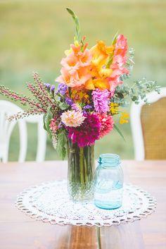 spring floral centerpiece, photo by Paper Antler http://ruffledblog.com/jackson-meadow-wedding #flowers #centerpieces