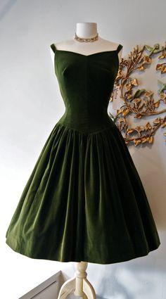 Elegant olive green couture dress in luminous velveteen, 1950s. Image © xtabayvintage (Etsy).