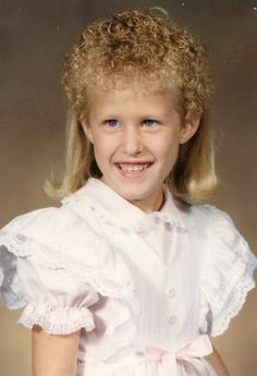 """Cheers to the parents who thought, """"Lets give her a mullet.. then perm the top."""""""