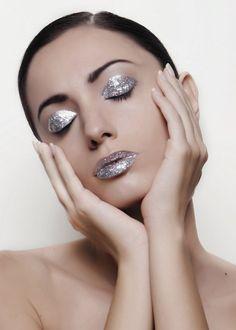 Silver glitter eye makeup and lipstick.