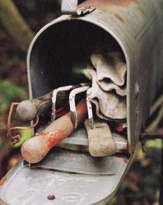 Use an old mailbox to house your small tools close to your flowers & garden. Decorate the mailbox for instant garden decor!