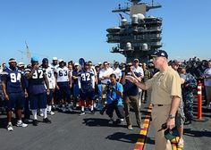 SAN DIEGO (Aug. 28, 2013) Capt. Christopher Bolt, commanding officer of the aircraft carrier USS Ronald Reagan (CVN 76), welcomes the San Diego Chargers during a morale boosting event aboard the ship.