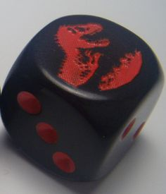 "CatMonkeyGames@aol.com $4.00 Pair Jurassic Park Dice. Logo is engraved on side ""6""."