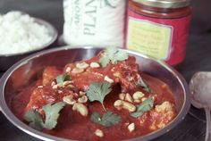 Tikka Makhani Chicken Curry - ingredients: Calcutta Kitchens Makhani Tikka sauce, 1 lb. chicken thighs (cut into med-size pieces), 1/4 c toasted and crushed cashews, handful cilantro leaves and Indian ghee (clarified butter) or olive oil / Preparation: 1) douse a little ghee or olive oil in a hot pan; tip in the chicken thighs. 2) Brown chicken on all sides, knock down the heat and add Tikka Makhani simmer sauce with 1/4 c water. 3) Simmer for 30 mins until chicken is tender.
