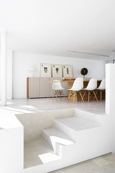 Clean and white dining room interior #architecture #chair #clean #design #interior