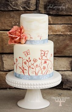 A pretty wedding cake with roses and hand painted butterflies. #wedding #cake