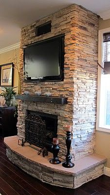 tv on stone fireplace | Christine Fife Interiors - Design With Christine