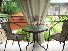 Nice cloth shower curtains on bamboo rods turn our small front porch into an intimate little outdoor room. Offers shade in the heat of the day; protection from light rain showers and seating for 4, for drinks before or after dinner!