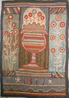 One of my favorite antique reproduction Quilts  hand stitchery rugs... Love the colors and the design...sooo early looking!