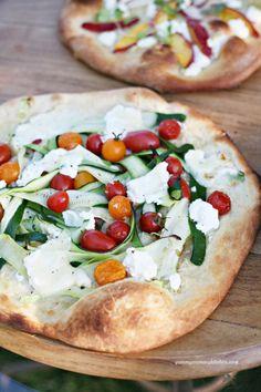 Zucchini ribbon, cherry tomato, and burrata pizza. So light and delicious for summer.