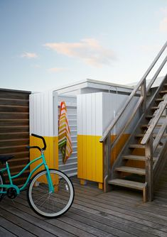yellow striped outdoor shower, beach cruiser