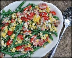 Green Bean Garden Salad, a 'real' garden salad, fresh beans, tomatoes, corn tossed in tangy feta dressing. Recipe, tips, nutrition data, Weight Watchers points at Kitchen Parade.
