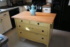kitchen island from an old dresser and a piece of butcher block.