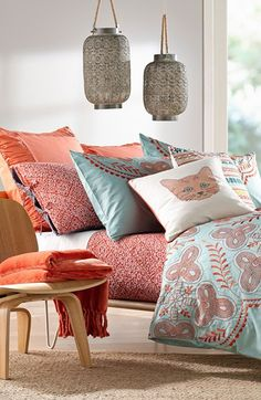 Love this bed collection. The mix of mint and coral infused with different patterns is simply beautiful.
