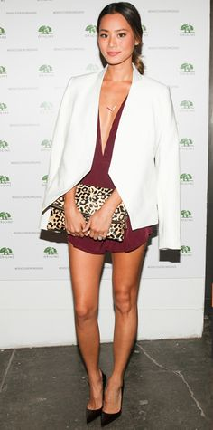 Jamie Chung dialed back the raciness factor and grounded her plunging burgundy romper with a white tuxedo blazer, a single delicate pendant, a leopard print clutch and classic black pumps.