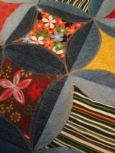 Small denim quilt made using outgrown blue jeans and a set of fat quarters.