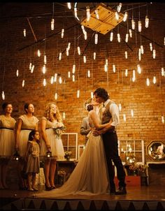 love the lights hanging lights, wedding lighting