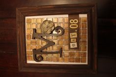 Old frame, backsplash from Home Depot, a letter from a craft store, and scrapbook letters/numbers...bunch of hot glue. It is super-easy and it's a personalized gifty...