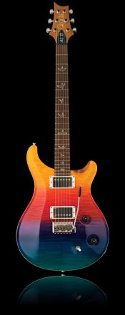 """The Al Di Meola Prism features a curly maple custom """"10"""" top with mahogany back, 25"""" scale length, 22 fret Cocobola fingerboard, Pattern Regular neck carve, PRS low mass locking tuners, bird inlays and a tremolo bridge."""