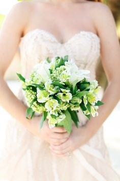 Bouquet full of greenery and lilies: http://www.stylemepretty.com/destination-weddings/2014/06/27/intimate-belize-wedding/ | Photography: Alea Lovely - http://alealovely.com/
