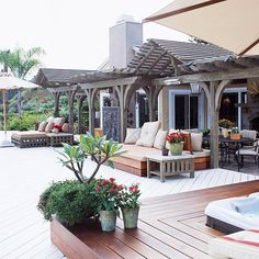 Spectacular deck design using distressed fir arbor and built-in seating, lounging areas.  BHG