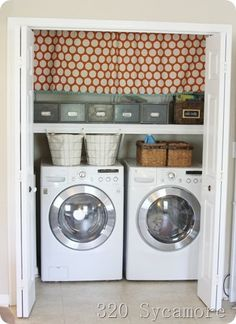 Small laundry closet made cute and functional with lots of storage (baskets and holders hanging on the L and R inside walls that you can't see in the pic)