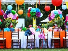 Again, these giant mexican paper flower pom poms... love the addition of paper lanterns and big flowers on chairs