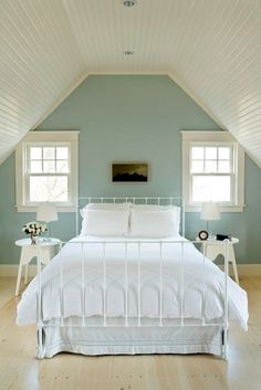 Quiet Moments from Ben Moore with White Dove trim.  Very soothing and tranquil color.