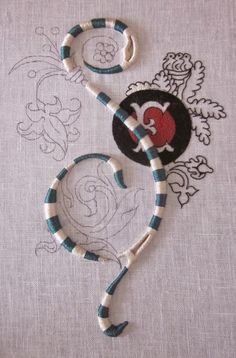 Another fantastic monogram from Elisabetta Ricami a Mano... High relief satin stitch, exquisitely done.