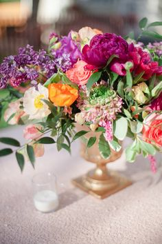 Sequin linens and colorful floral centerpiece | Connie Dai Photography | http://burnettsboards.com/2014/01/style-backyard-engagement-party/