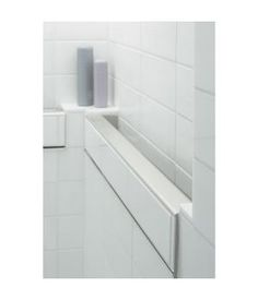 Koehler built in grab bar rail for bath- completely disguised accessibility. Nation's Building News Online for May 2, 2011