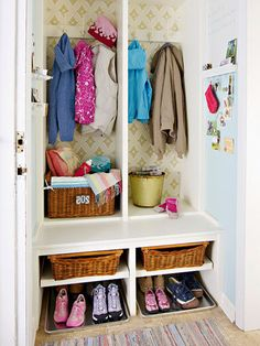 Removing doors and adding shelves turns a microscopic entry closet into a locker-style catchall to gather gear for the entire family. Old swim baskets with tea-towel liners stow off-season supplies on a top shelf, while hooks attached to the back wall transform large sections into lockers for coats and bags. Stainless-steel baking trays on the floor collect drips from shoes and boots.