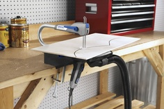 The dust port adapter attaches to most household vacuum cleaners to the Moto-Saw, keeping the work space clean.