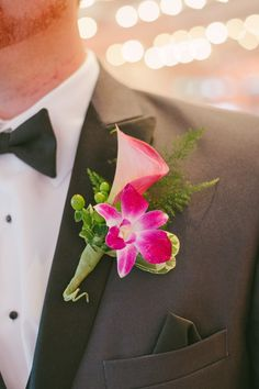 orchid and calla lily boutonniere, photo by Dixie Pixel Photography http://ruffledblog.com/virginia-boathouse-wedding #grooms #boutonnieres