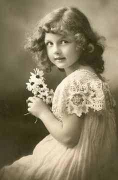 vtg - wouldn't it be sweet to have some old pictures of little girls in frames in a collage on the wall