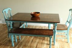 Dining room table w/ stained top & painted bottom. --I love how the chairs match.I need to do this with our dining set
