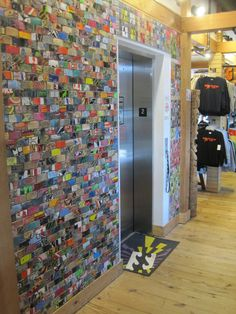 Art of Board wall surface inside K-Coast Surf Shop, Ocean City, MD. Made from 100% recycled skateboard tiles.