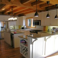 Timber frame on pinterest timber frames timber frame for Post and beam kitchen ideas