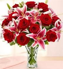 Google Image Result for http://www.1800flowerscarleplace.com/images/catalog/Flowers/1436/Lenox%20Crystal%20Vase%20with%20Rose%20&%20Lily%20Bouquet_Large.jpg (throw in some purple and you have my wedding bouquet)