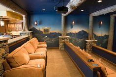 Design Inspiration - the movie room.  Check it out ... I love it .... couches if you really want to recline . the bar and serving area behind ..plenty of seating ... the wall mural gives depth to the room and makes it feel warm and homey!!