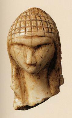 """Head of a woman known as the """"Venus of Brassempouy"""" – Gravettian (c. 27,000 BCE) Mammoth tusk.   Brassempouy (Landes, Frances)   Saint-Germain-en-Laye, Musée des Antiquites nationales"""