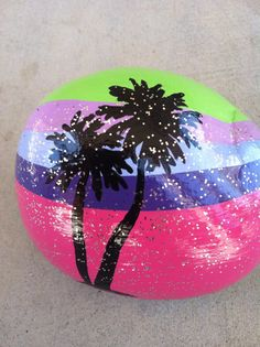 Hand painted rock. Beach inspired. Brightly colored. Palm trees. via Etsy