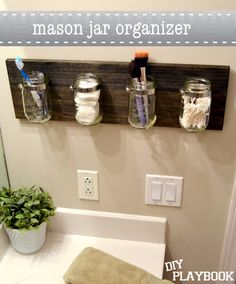 Mason Jar Organizer - This DIY storage craft would look great in a bathroom or a craft room. Use recycled mason jars to save money.