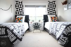 Nest Design Studio | project nursery. Black and White Shared Room with a pop of geometric color.