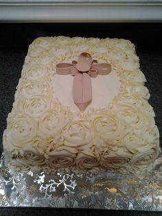 First comunion cake - Pina colada cake with BC rossetttes and fondant ribbon cross