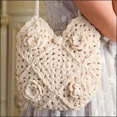 Crocheted granny square bag pattern with flowers.