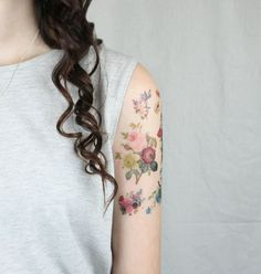 Temporary tattoos inspired by vintage flower illustrations.
