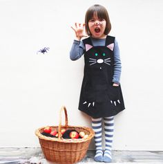 Halloween costume black cat dress. wildthingsdresses via Etsy.